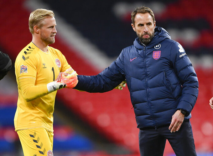 England manager Gareth Southgate, right, congratulates Denmark's Kasper Schmeichel after the UEFA Nations League soccer match between England and Denmark at Wembley Stadium in London, England, Wednesday, Oct. 14, 2020. (Toby Melville/Pool via AP)