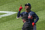 Atlanta Braves' Ozzie Albies, top, gestures as he rounds bases after hitting a two-run home run during the sixth inning of a baseball game against the Washington Nationals in Washington, Sunday, Sept. 13, 2020. (AP Photo/Manuel Balce Ceneta)
