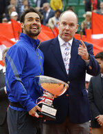 Italy's Fabio Fognini, left, poses for a photo with Prince Albert II of Monaco, right, after his victory over Serbia's Dusan Lajovic in the men's singles final match of the Monte Carlo Tennis Masters tournament in Monaco, Sunday, April, 21, 2019. (AP Photo/Claude Paris)