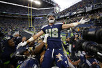 Seattle Seahawks tight end Jacob Hollister celebrates after he scored a touchdown against the Tampa Bay Buccaneers in overtime of an NFL football game Sunday, Nov. 3, 2019, in Seattle. (AP Photo/Scott Eklund)
