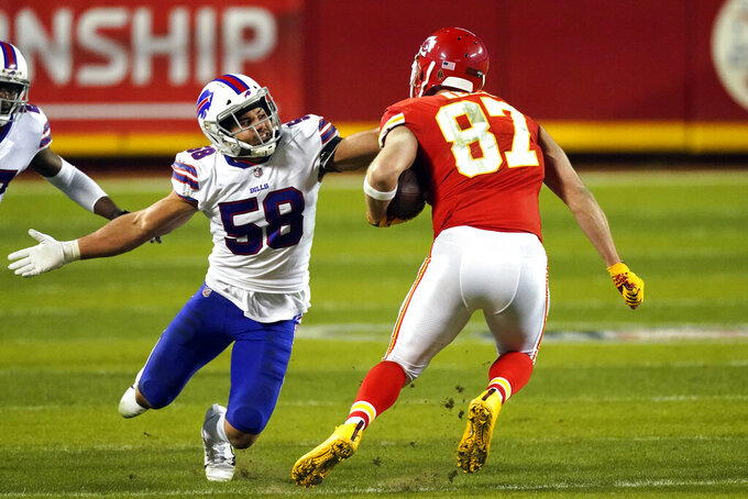 FILE - Buffalo Bills linebacker Matt Milano (58) tackles Kansas City Chiefs tight end Travis Kelce (87) during the second half of the AFC championship NFL football game in Kansas City, Mo., in this Sunday, Jan. 24, 2021, file photo. The Buffalo Bills' salary-cap constraints have led starting linebacker Matt Milano to decide he will test free agency next month, a person with direct knowledge of the situation told The Associated Press on Friday, Feb. 19, 2021. The person spoke to The AP on the condition of anonymity because the discussions between the player and team have been private. (AP Photo/Charlie Riedel, File)