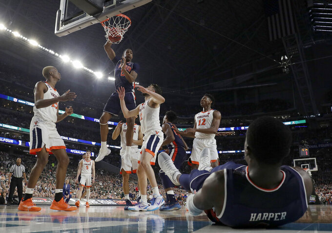 Auburn's Horace Spencer (0) dunks during the first half in the semifinals of the Final Four NCAA college basketball tournament against Virginia, Saturday, April 6, 2019, in Minneapolis. (AP Photo/David J. Phillip)