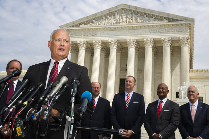 Nebraska Attorney General Doug Peterson with a bipartisan group of state attorneys general speaks to reporters in front of the U.S. Supreme Court in Washington, Monday, Sept. 9, 2019. A bipartisan coalition of 48 states along with Puerto Rico and the District of Columbia said Monday it is investigating whether Google's search and advertising business is engaged in monopolistic behavior. It follows a Friday announcement of a similar multistate probe targeting Facebook. (AP Photo/Manuel Balce Ceneta)