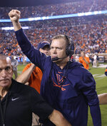 Virginia coach Bronco Mendenhall celebrates the team's 31-24 win over Florida State in an NCAA college football game in Charlottesville, Va., Saturday, Sept. 14, 2019. (AP Photo/Andrew Shurtleff)