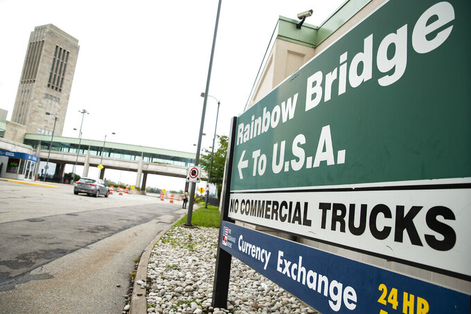A vehicle crosses the International Rainbow Bridge from Niagara Falls, Ont. into Niagara Falls, N.Y. on Wednesday, Oct. 13, 2021. The U.S. will reopen its land borders to nonessential travel next month, ending a 19-month freeze due to the COVID-19 pandemic as the country moves to require all international visitors to be vaccinated against the coronavirus. The new rules, to be announced Wednesday, Oct. 13, 2021 will allow fully vaccinated foreign nationals to enter the U.S. regardless of the reason for travel. (Aaron Lynett/The Canadian Press via AP)