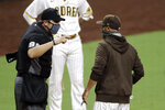San Diego Padres manager Jayce Tingler, right, argues with umpire Mark Ripperger after being ejected during the seventh inning of the team's baseball game against the Los Angeles Dodgers, Wednesday, Aug. 5, 2020, in San Diego. (AP Photo/Gregory Bull)