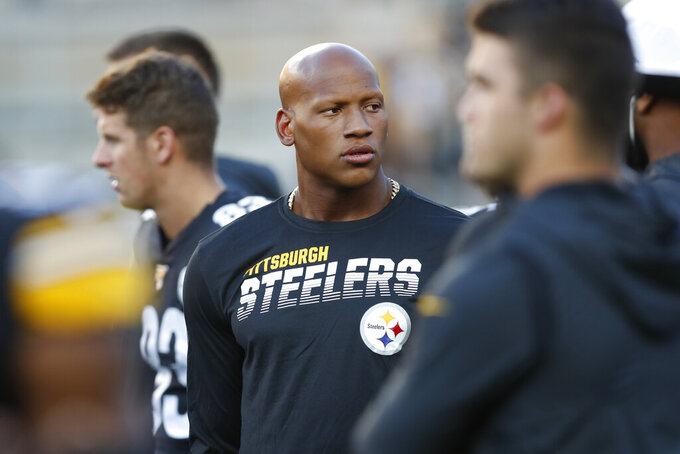 FILE - In this Aug. 9, 2019, file photo, Pittsburgh Steelers Ryan Shazier, center, watches warmups before an NFL preseason football game against the Tampa Bay Buccaneers in Pittsburgh. The Pittsburgh Steelers have placed the inside linebacker Ryan Shazier on the reserved/retired list. But the team says the move doesn't rule out the possibility of Shazier playing again.  (AP Photo/Keith Srakocic, File)