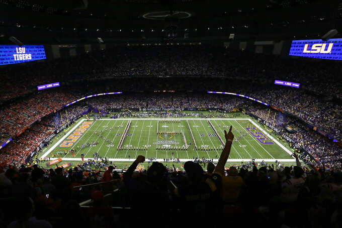 Fans cheer before a NCAA College Football Playoff national championship game between Clemson and LSU Monday, Jan. 13, 2020, in New Orleans. (AP Photo/Eric Gay)