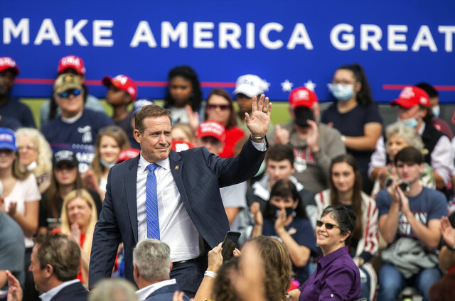 U.S. Rep. Ted Budd waves to the crowd during a campaign event at the Piedmont Triad International Airport in Greensboro, N.C., Tuesday, Oct. 27, 2020. (Khadejeh Nikouyeh/News & Record via AP)