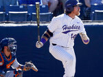 Washington's Joe Wainhouse watches his solo home run against against Cal State Fullerton during the fourth inning of an NCAA college baseball tournament super regional game Saturday, June 9, 2018, at Goodwin Field in Fullerton, Calif. (Luis Sinco/Los Angeles Times via AP)