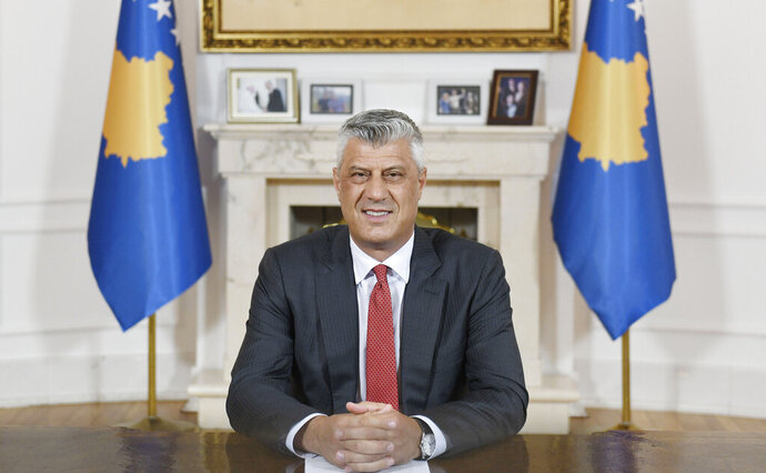 Kosovo president Hashim Thaci speaks during a televised address to the nation, in Pristina, Kosovo, Monday, June 29, 2020. Kosovo's president on Monday denied committing war crimes during and after a 1998-1999 armed conflict between ethnic Albanian separatists and Serbia and said he would resign if the indictment is confirmed by an international war crimes court. (AP Photo/Astrit Ibrahimi)