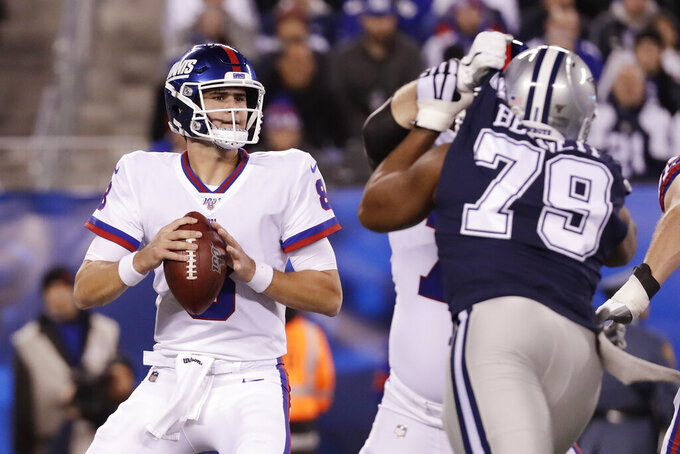 New York Giants quarterback Daniel Jones (8) looks to pass against the Dallas Cowboys during the first quarter of an NFL football game, Monday, Nov. 4, 2019, in East Rutherford, N.J. (AP Photo/Adam Hunger)