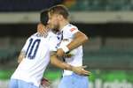Ciro Immobile celebrates scoring a penalty against Hellas during Italian serie A soccer match between Verona and Lazio, at the Bentegodi stadium, in Verona, Italy, Sunday, July 26, 2020. (Paola Garbuio/Lapresse via AP)