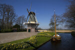 View of the empty, world-renowned, Dutch flower garden Keukenhof which was closed because of the coronavirus, in Lisse, Netherlands, Thursday, March 26, 2020. Keukenhof, which attracted 1.5 million visitors last year, will not open after the Dutch government extended its ban on gatherings to June 1 in an attempt to slow the spread of the virus. Instead of opening, it will allow people to virtually visit its colorful floral displays through its social media and online channels. The new coronavirus causes mild or moderate symptoms for most people, but for some, especially older adults and people with existing health problems, it can cause more severe illness or death. (AP Photo/Peter Dejong)
