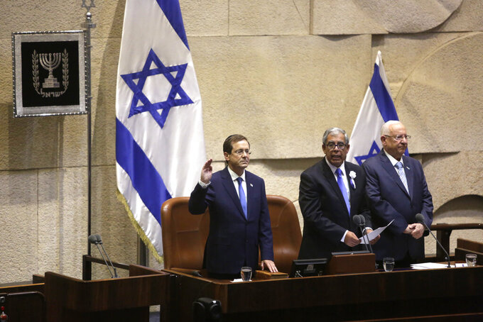 Israel's President-elect Isaac Herzog, left, Speaker of the Knesset, Mickey Levi, center, and Israel's outgoing President Reuven Rivlin during his sworn ceremony in the Knesset in Jerusalem, Wednesday, July 7, 2021. (AP Photo/Sebastian Scheiner)