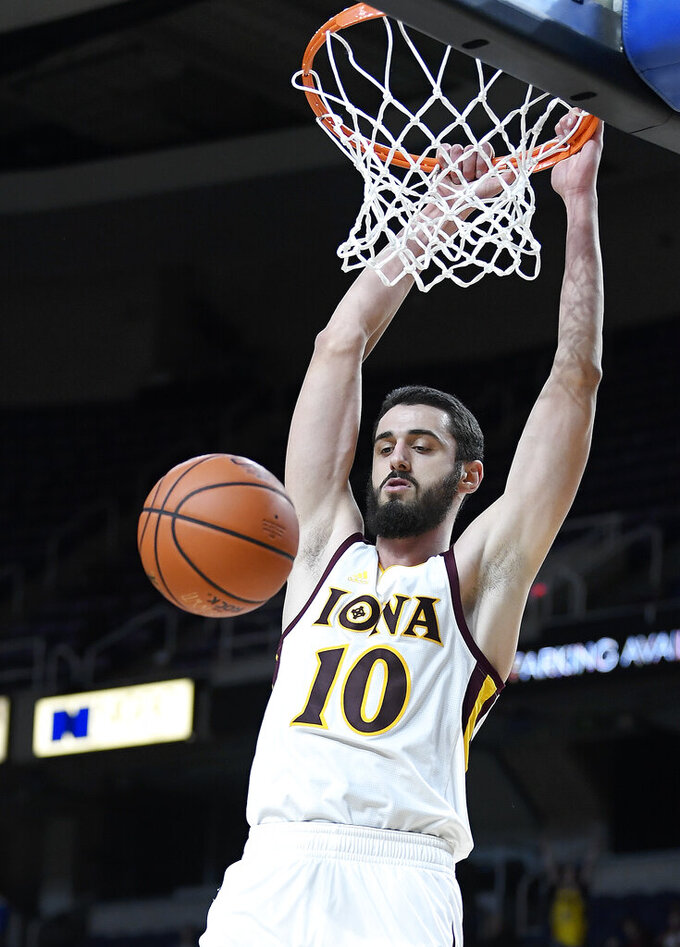 Iona forward Andrija Ristanovic (10) dunks against Monmouth during the first half of the championship NCAA college basketball game during the Metro Atlantic Athletic Conference tournament, Monday, March 11, 2019, in Albany, N.Y. (AP Photo/Hans Pennink)