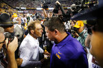 Alabama head coach Nick Saban, left, shakes hands with LSU head coach Ed Orgeron after their NCAA college football game in Baton Rouge, La., Saturday, Nov. 3, 2018. Alabama won 29-0. (AP Photo/Gerald Herbert)