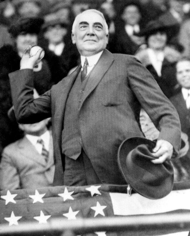 FILE - In this April 13, 1921, file photo, President Warren G. Harding throws out the first ball to open the Washington Senators' baseball season. The grandson of U.S. President Warren G. Harding has gone to court seeking to dig up the Republican's remains from the presidential memorial where they have lain since 1927. (AP Photo/FIle)