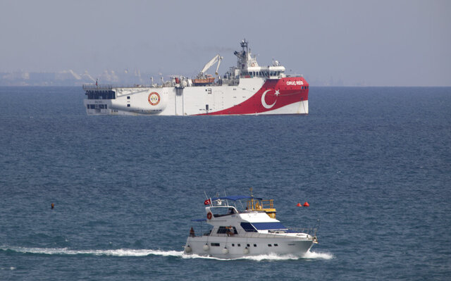FILE - In this Sept. 27, 2020 file photo, Turkey's research vessel Oruc Reis is anchored off the coast of Antalya on the Mediterranean Sea in Turkey. In a tweet Monday, Nov. 30, 2020, Turkey's energy ministry said the Oruc Reis had returned to port in Antalya after completing two-dimensional seismic research in the Demre field. (AP Photo/Burhan Ozbilici, File)