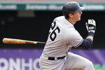 New York Yankees' DJ LeMahieu hits an RBI-single in the third inning of a baseball game against the Cleveland Indians, Thursday, April 22, 2021, in Cleveland. (AP Photo/Tony Dejak)
