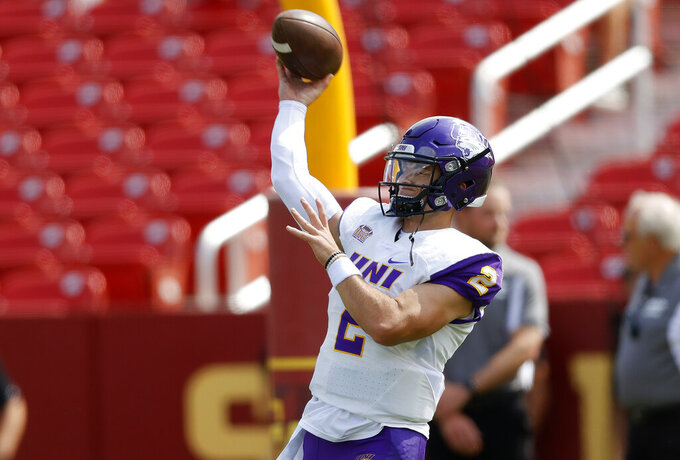 Northern Iowa quarterback Will McElvain (2) warms up before an NCAA college football game against Iowa State, Saturday, Sept. 4, 2021, in Ames, Iowa. (AP Photo/Matthew Putney)