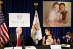Vice President Mike Pence, left, speaks with Kia Farrell with her sons Ollie Farrell-Kalajainnen, 11-months-old, and Ocean Farrell-Lindsey, 11, during a stop at A Woman's Place Medical Clinic in Pinellas Park, Fla., on Wednesday Aug. 5, 2020, where he discussed pro life options with staffers and patrons. Farrell said she would have likely aborted Ollie if she had not received counseling through the clinic, which provides pregnancy testing, sonograms, well woman care, counseling, life skills training and health education at four locations in Pinellas and Hillsborough counties. (Douglas R. Clifford/Tampa Bay Times via AP)