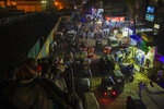 CLARIFIES SECOND AND THIRD SENTENCES -- FILE - In this Nov. 24, 2019 file photo, motorized rickshaws known as tuk-tuks, crowd a street in Cairo, Egypt. On Tuesday, Feb. 11, 2020, the official statistics agency announced Egypt's fast-growing population hit 100 million people, presenting a pressing problem for an already overburdened country with limited resources. The figure is an increase of 7 million since the publication of the latest census results in 2017. (AP Photo/Nariman El-Mofty, File)