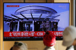 """People watch a TV news program reporting North Korea's announcement with a file footage of North Korean leader Kim Jong Un, at the Seoul Railway Station in Seoul, South Korea, Sunday, Dec. 8, 2019. North Korea said Sunday it carried out a """"very important test"""" at its long-range rocket launch site that U.S. and South Korean officials said the North had partially dismantled as part of denuclearization steps. The letters read"""