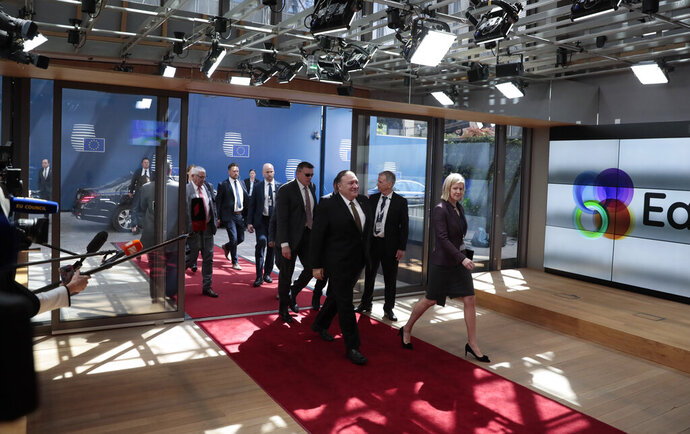 U.S. Secretary of State Mike Pompeo, center, arrives for a meeting of the US and the E3 at the Europa building, Monday, May 13, 2019. The EU backers of the Iran nuclear deal meet with U.S. Secretary of State Mike Pompeo to discuss ways to keep the pact afloat. (AP Photo/Virginia Mayo)