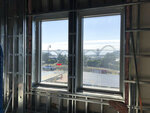 In this July 22, 2019, photo, the Yaquina Bay Bridge is seen through the window of Oregon State University's Marine Studies Building, which is being erected in a tsunami inundation zone in Newport, Ore. Experts say there is a 37 percent chance that a large Cascadia earthquake will occur off Oregon's shore in the next 50 years, generating a tsunami that will hit many coastal towns. (AP Photo/Andrew Selsky)