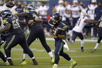 Seattle Seahawks quarterback Russell Wilson passes against the New England Patriots during the second half of an NFL football game, Sunday, Sept. 20, 2020, in Seattle. (AP Photo/Elaine Thompson)