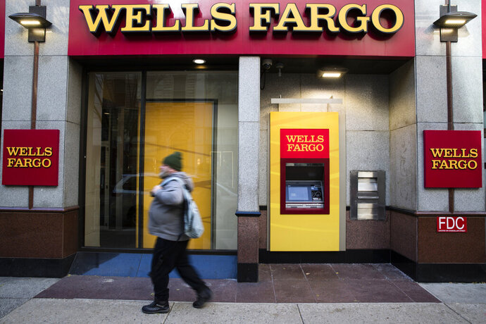 FILE- This Nov. 29, 2018, file photo shows a Wells Fargo bank location in Philadelphia. Wells Fargo customers are experiencing issues with accessing online or mobile banking as well as other banking services, after a fire happened at one of the bank's data centers. (AP Photo/Matt Rourke, File)