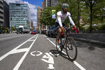 Siddeeq Shabazz rides his bicycle by Philadelphia City Hall on Friday, Sept. 3, 2021. Shabazz got into cycling because of the pandemic. Now he rides 200 miles a week, leads team rides and has been on the cover of a bicycling publication. (Alejandro A. Alvarez/The Philadelphia Inquirer via AP)