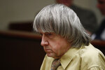 David Turpin sits in a courtroom Friday, Feb. 22, 2019, in Riverside, Calif. Turpin and his wife, Louise, who shackled some of their 13 children to beds and starved them pleaded guilty on Friday to torture and other abuse. (AP Photo/Jae C. Hong, Pool)