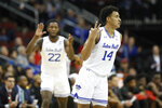 Seton Hall guard Jared Rhoden (14) reacts with guard Myles Cale (22) applauding him during the first half of an NCAA college basketball game against Maryland, Thursday, Dec. 19, 2019, in Newark, N.J. (AP Photo/Kathy Willens)