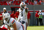 Virginia quarterback Bryce Perkins (3) calls a play during the second half of an NCAA college football game in Raleigh, N.C., Saturday, Sept. 29, 2018. (AP Photo/Chris Seward)