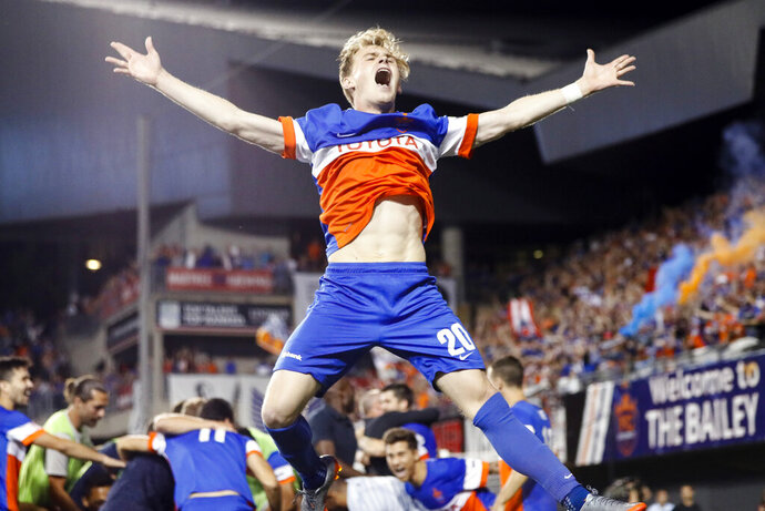 FILE - In this June 28, 2017, file photo, FC Cincinnati midfielder Jimmy McLaughlin reacts after winning their penalty shoot-out during a U.S. Open Cup soccer match against the Chicago Fire in Cincinnati. Cincinnati joins MLS as the league's 24th team. The club is coming off a tremendous season in the USL, finishing with a 28-8-3 record to claim the league's regular-season title. (AP Photo/John Minchillo, File)