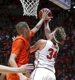 Utah center Jayce Johnson (34) is fouled by Oregon State forward Kylor Kelley (24) while shooting during the second half of an NCAA college basketball gamep Saturday, Feb. 2, 2019, in Salt Lake City. Oregon State won 81-72. (AP Photo/Chris Nicoll)