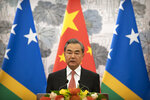 Chinese Foreign Minister Wang Yi talks during a ceremony to mark the establishment of diplomatic relations between the Solomon Islands and China at the Diaoyutai State Guesthouse in Beijing, Saturday, Sept. 21, 2019. (AP Photo/Mark Schiefelbein, Pool)