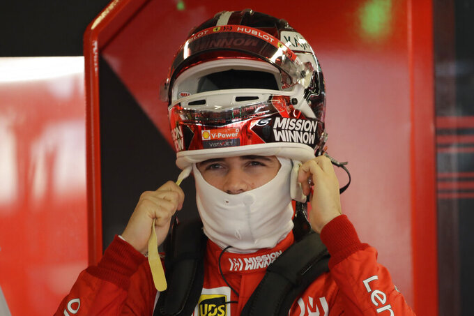 Ferrari driver Charles Leclerc of Monaco wears the helmet during the second free practice at the Yas Marina racetrack in Abu Dhabi, United Arab Emirates, Friday, Nov. 29, 2019. The Emirates Formula One Grand Prix will take place on Sunday. (AP Photo/Luca Bruno)