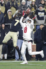 Wisconsin cornerback Deron Harrell (8) breaks up a pass to Purdue wide receiver Isaac Zico (7) during the second half of an NCAA college football game in West Lafayette, Ind., Saturday, Nov. 17, 2018. Wisconsin defeated Purdue 47-44 in overtime. (AP Photo/Michael Conroy)