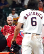 Los Angeles Angels' Jonathan Lucroy, left, is carted off the field after colliding with Houston Astros' Jake Marisnick (6) at home plate during the eighth inning of a baseball game Sunday, July 7, 2019, in Houston. (AP Photo/David J. Phillip)