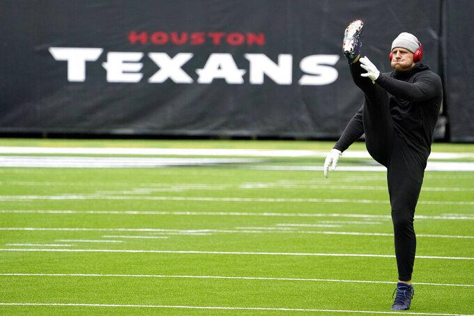 Houston Texans defensive end J.J. Watt warms up before an NFL football game against the Cincinnati Bengals Sunday, Dec. 27, 2020, in Houston. (AP Photo/Sam Craft)