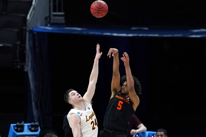 Oregon State guard Ethan Thompson (5) shoots over Loyola Chicago guard Tate Hall (24) during the first half of a Sweet 16 game in the NCAA men's college basketball tournament at Bankers Life Fieldhouse, Saturday, March 27, 2021, in Indianapolis. (AP Photo/Jeff Roberson)