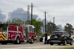 A Harris County Sheriff's Office deputy blocks Market Street, near Appelt Drive, as firefighters battle a fire at a chemical storage facility in the 1000 block of Lakeside Drive, on Wednesday, April 7, 2021, in Channelview, Texas. (Godofredo A. Vásquez/Houston Chronicle via AP)