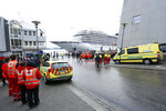 The cruise ship Viking Sky arrives at port in Molde, Norway, Sunday March 24, 2019, after having problems and issuing a Mayday call on Saturday in heavy seas off Norway's western coast. Rescue helicopters took more than 475 passengers from a cruise ship that got stranded off Norway's western coast in bad weather before the vessel departed for a nearby port under escort and with nearly 900 people still on board, the ship's owner said Sunday. (Svein Ove Ekornesvag/NTB scanpix via AP)