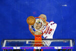 Philadelphia 76ers' Ben Simmons tries to dunk during the second half of an NBA basketball game against the Boston Celtics, Thursday, Jan. 9, 2020, in Philadelphia. (AP Photo/Matt Slocum)