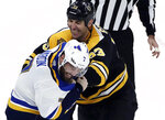 Boston Bruins defenseman Zdeno Chara (33) and St. Louis Blues left wing Pat Maroon (7) fight during the first period of an NHL hockey game Thursday, Jan. 17, 2019, in Boston. (AP Photo/Elise Amendola)