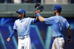 Kansas City Royals' Billy Hamilton (6) and Bubba Starling (11) celebrate after their baseball game against the Chicago White Sox Thursday, July 18, 2019, in Kansas City, Mo. The Royals won 6-5. (AP Photo/Charlie Riedel)