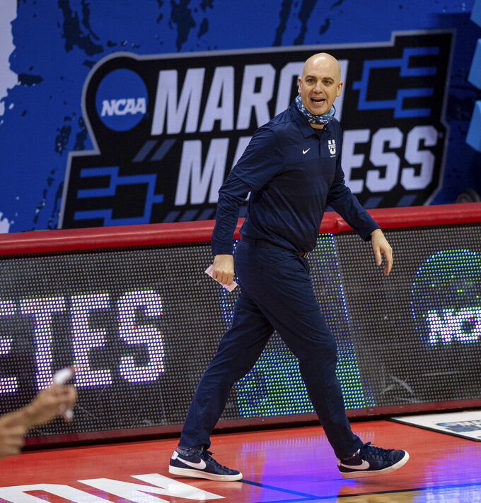 Utah State head coach Craig Smith paces the sideline during the first half of a first round game against Texas Tech in the NCAA men's college basketball tournament, Friday, March 19, 2021, in Bloomington, Ind. (AP Photo/Doug McSchooler)